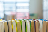 Fototapety Hard covered library books on shelf with blurred background