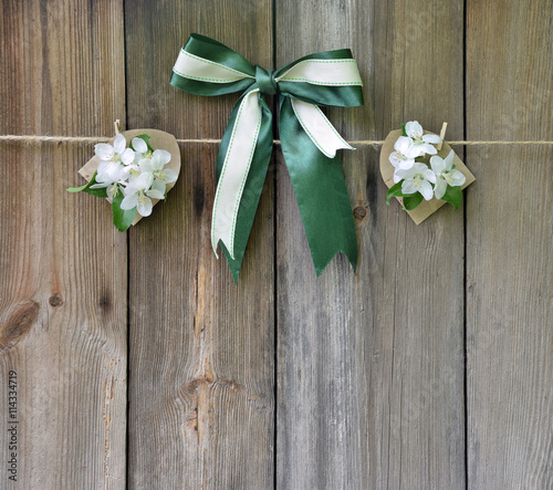 Blossoming apple and bow on a wooden background. © 151115