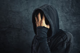 Hooded person fighting addiction crisis