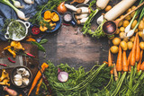Fototapety Vegetables cooking ingredients for tasty vegetarian dishes. Carrot , potato , onion , mushrooms , garlic , thyme , parsley on dark rustic wooden background, frame
