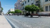 4K .Silhouettes of people on  summer city street.  Accelerate shoot