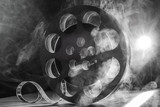 Fototapety Reel of film retro in the smoke. black and white