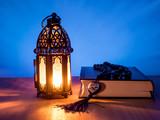 "muslim style's lantern shining on text ""Prophet Muhammad"""