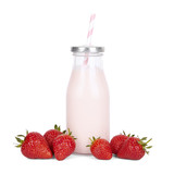 Drinks and milk shakes - a strawberry milkshake in a vintage glass bottle with straw and fruit isolated on a white background