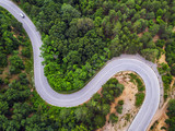 Aerial view over mountain road - 114404975