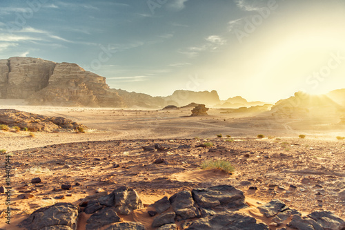 Poster Desert Landscape of Wadi Rum in Jordan, with a sunset, stones, b
