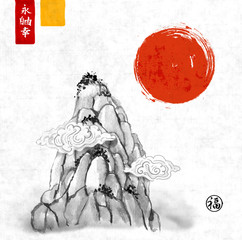 High mountain peak and red sun hand drawn with ink in traditional Chinese style on rice paper background. Contains hieroglyphs - eternity, freedom, happiness, well-being