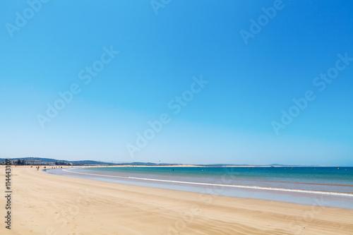 Papiers peints Maroc Clear blue sky over emerald sea and yellow sandy beach, Agadir, Morocco