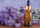 Lavender oil bottle on wood background.Essential oil, natural remedies. - 114501933