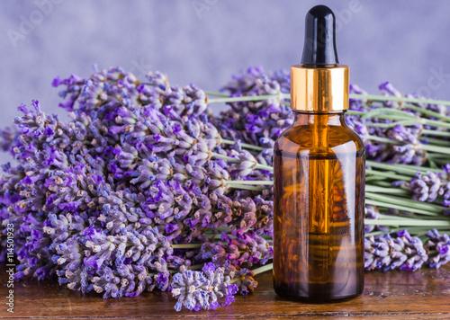 Papiers peints Lavande Lavender oil bottle on wood background.Essential oil, natural remedies.