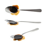 Steel spoon in a puddle of soy sauce