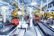Leinwanddruck Bild - robotic arms in a car plant