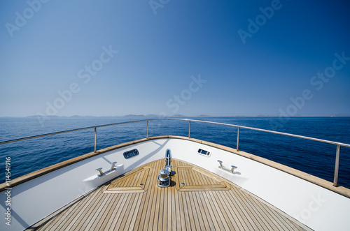 Wide angle shot of front of the yacht in summer time Plakát