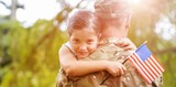 Portrait of girl hugging army officer father
