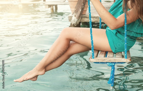 Female legs above water