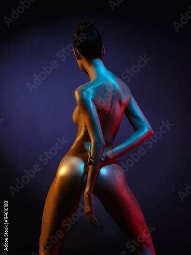 Foto op Aluminium womenART fashion art photo of sexy nude stripper in the night-club. Perfect female body with oil skin
