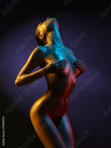 Poster fashion art photo of sexy nude stripper in the night-club
