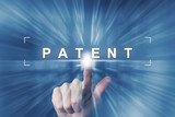 hand clicking on patent button - 114613365