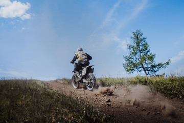 rider going uphill from under rear wheels of mud and stones © sportpoint