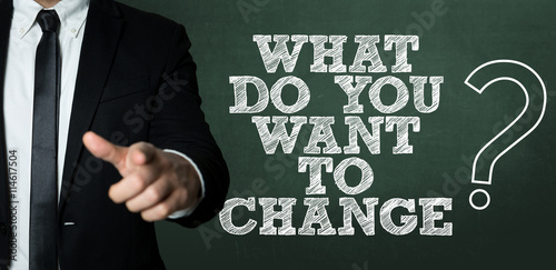 Business man pointing with the text: Do You Want to Change?