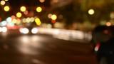 Soft focus traffic lights on city street at night