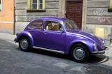 Classic car on the street European city - 114636920