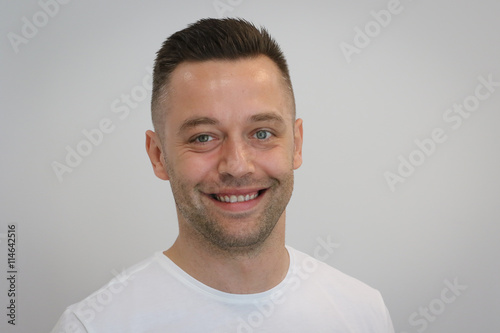 obraz lub plakat Portrait of young handsome man in white T-shirt