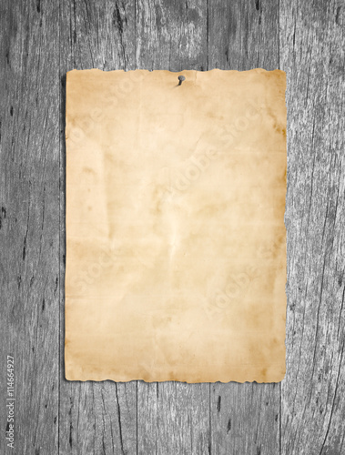 Old grunge paper on gray wood or wooden wall background Poster