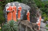 Line of Buddhist statues near Dambulla golden temple