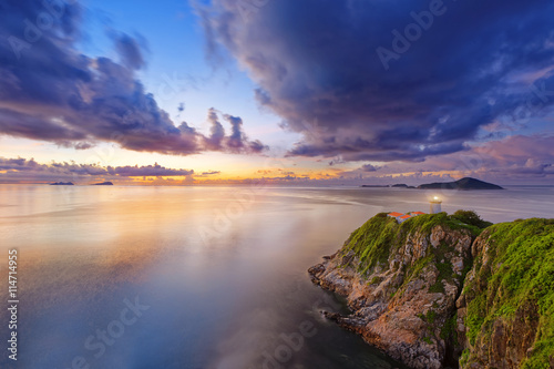 Hong Kong lighthouse during sunrise Poster