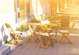 Empty cafe terrace in bright sunlight - 114739396
