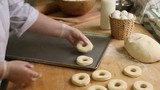 Chef cooks on protoven blank donuts, bagel