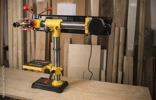 Poster Vertical drilling machine on table with tools