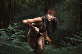 Native huntress in the forest
