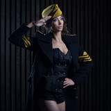portrait of girl in a black aviator uniform with hat