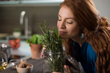 Woman smelling rosemary