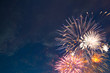 Beautiful colorful holiday fireworks in the evening sky