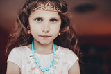 Beautiful little girl wearing a crown with crystals and necklace handmade