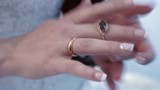The bride is wearing a wedding ring on your fingers