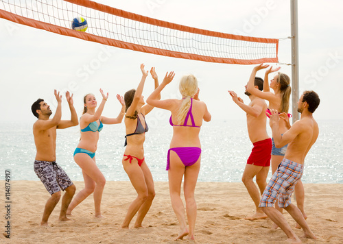 Friends playing volleyball on a beach