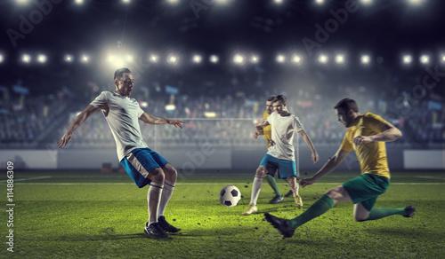 Fototapeta Hot football moments . Mixed media