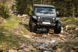 off-road extreme expedition on black jeep wrangler