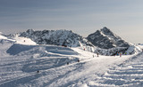 Winter panorama of Kasprowy ski slope and Krivan in the background, Tatra mountains