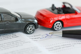 Fototapety Insurance policy contract concept with toy model cars having a crash or accident