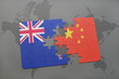 puzzle with the national flag of new zealand and china on a world map background. 3D illustration