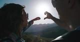 Couple Enjoying the sunrise in the mountains, love scene, slow motion