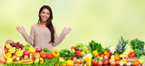 Happy asian girl with fruits and vegetables.