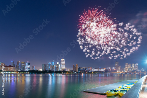 Poster fireworks by water in Singapore city