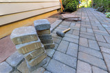 Stone Pavers and Tools for Side Yard Hardscape - 114954761