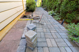 Stone Pavers and Tools for Side Yard Landscaping - 114954783